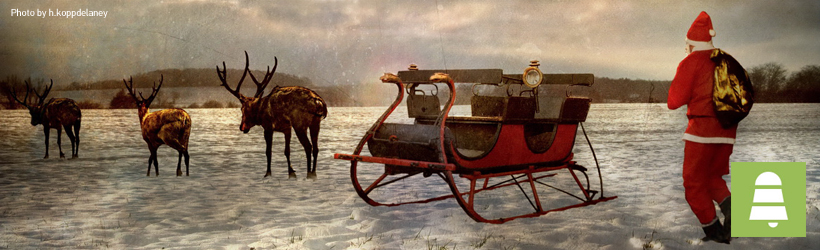 Santa Claus and reindeer in the snow grey sky h koppdelaney